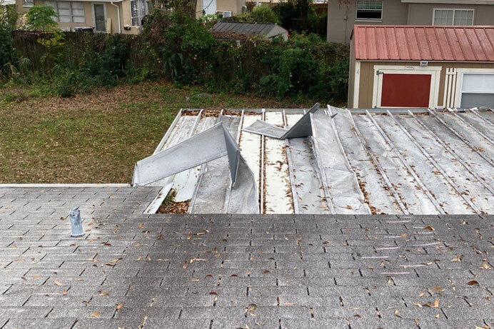 storm damage to a roof needing repair