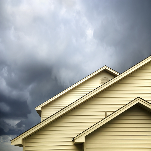 roof of a house under stormy skies
