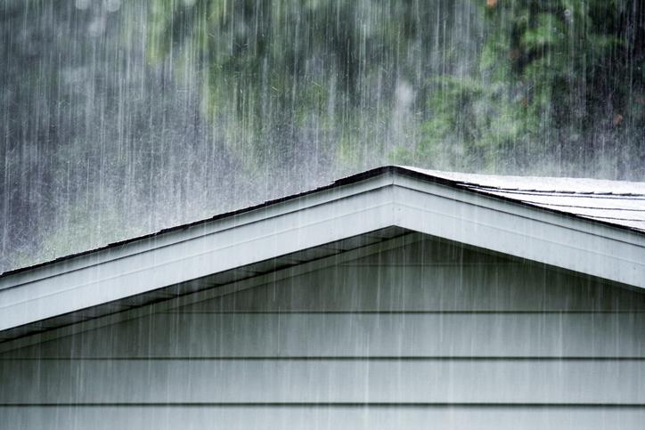 heavy rains falling on a roof